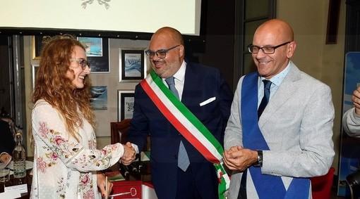 Da sinistra, Valeria Brignolo, Giorgio Giuffra e Domenico Abbo (presidente della Provincia di Imperia) durante il consiglio comunale solenne di Riva Ligure, il 22 settembre.